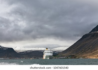 Cruise ship stopped in Isafjordur in a cloudy day, Iceland