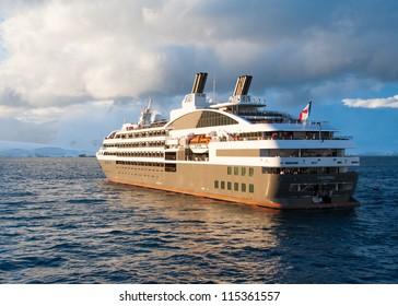 Cruise ship in sunset light