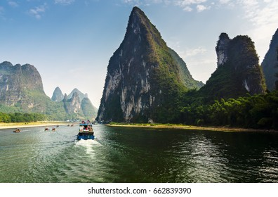 Cruise ship travels the magnificent scenic route along the Li river from Guilin to Yangshou in China.