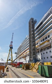 cruise ship under construction in a shipyard