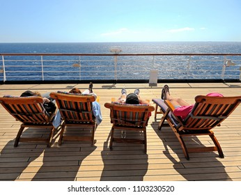 Cruise Ship Vacation. Four Cruise Guest Relaxing on the Deckchair.