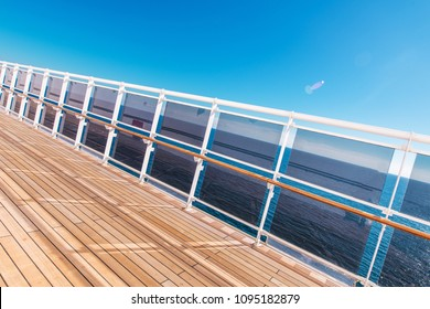 Cruise Ship Vacation Theme. Wooden Deck of the Cruise Vessel with Glassy Barriers and the Ocean Vista. Caribbean Vacation Time.