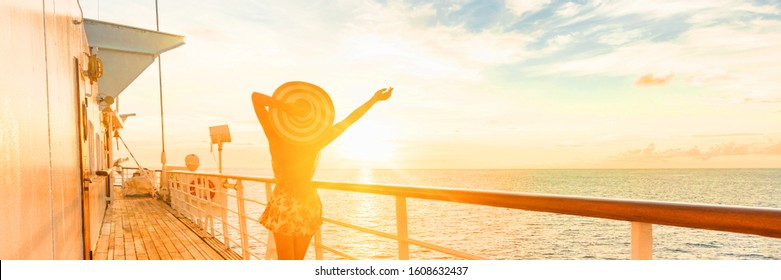 Cruise ship vacation travel woman having fun feeling free enjoying luxury elegant lady carefree on deck watching sunset on Caribbean winter holidays banner panorama. Cruiseship sailing on holiday.