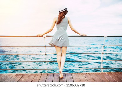 Cruise ship vacation woman enjoying travel at sea. Free happy woman looking at ocean. Woman in dress on luxury cruise liner boat.