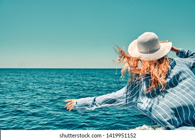 Cruise ship vacation woman enjoying travel vacation at sea. Free carefree happy girl travel at ocean or sea. Woman on a yacht enjoying the beautiful vacation.
