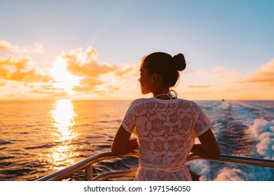 Cruise ship vacation woman watching sunset boat deck on summer travel. Silhouette of tourist relaxing on outdoor balcony of boat ferry.