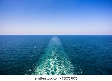 Cruise ship wake on the sea surface, ocean boat foam trail