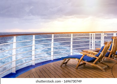 Cruise ship wooden deck chairson the main deck at sunset