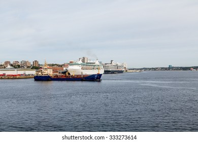 Cruise ships and freighters docked in the harbor at Halifax