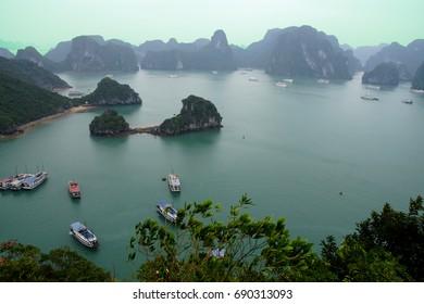 Cruise ships in Halong Bay among karst formations,  near Haiphong,  Vietnam