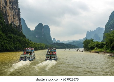 Cruise ships travel through magnificent scenic route along the Li river from Guilin to Yangshou in China