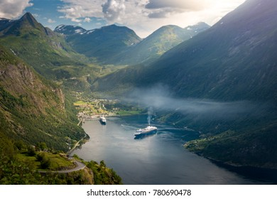 Cruise ships in waters of fiord, Norway, Scandinavia, Europe. High mountains over fjord