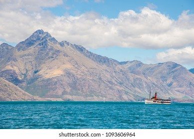 A cruise steam ship in lake Wakatipu, Queenstown, with Remarkable mountain in the background