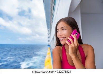 Cruise travel woman talking on the phone calling someone on travel vacation at ocean. Asian girl holidays. Internet international call concept. Tourist girl talking on the phone