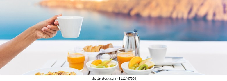 Cruise vacation breakfast woman drinking coffee at restaurant. Banner panorama of morning person eating holding coffee cup at luxury resort hotel.