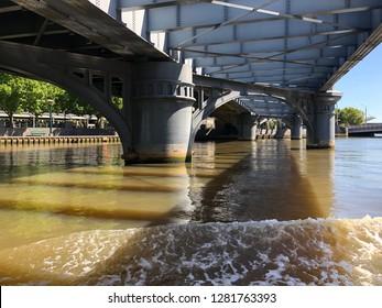 Cruise view under the bridge of Yarra River in Melbourne Australia