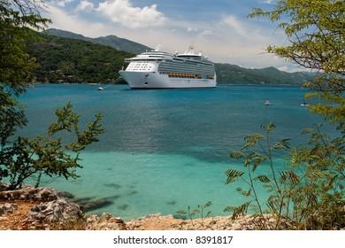 Cruiseship anchoring in a caribbean bay