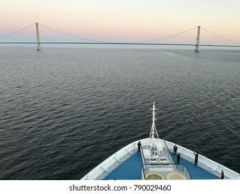Cruising in the Baltic Sea, Kattegat,  near Denmark and Sweden pass through the bridge of Storebaelt  by sunset and sunrise