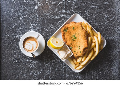 Crumbed fish and chips with coffee