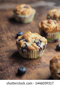 Crumble blueberry muffin on wooden table