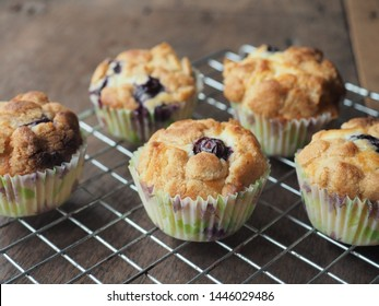 Crumble blueberry muffins on wooden table