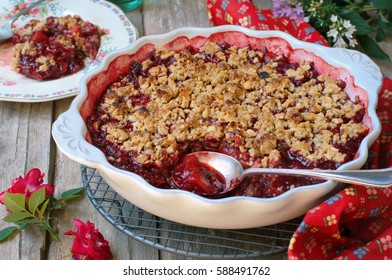 Crumble Cake/Pie with Poached Apple and Plum. Selective Focus