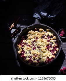Crumble pie with berries on wooden background. Style rustic.