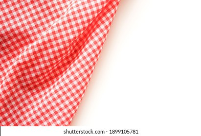 crumble pink plaid fabric or tablecloth on white background with copy space.