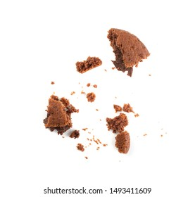 Crumbled chocolate butter cookie with chocolate filling isolated on white background. Brown round soft biscuits or broken sweet cocoa buns closeup
