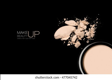 crumbled makeup powder foundation with text over black background for concept about cosmetics and make-up