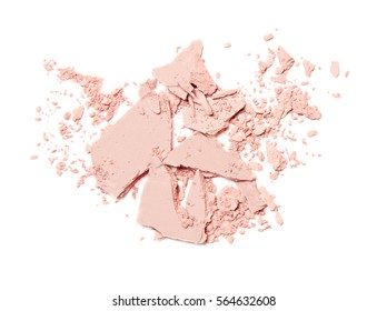 crumbled pink blush and eyeshadow isolated on white background