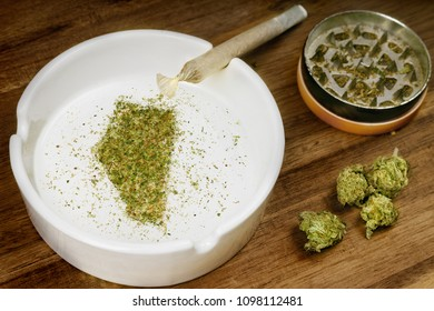 Crumbled weed in the shape of Alberta and a joint. (series)