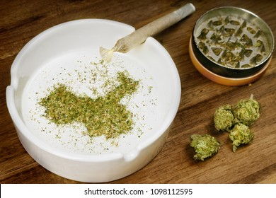 Crumbled weed in the shape of China and a joint. (series)