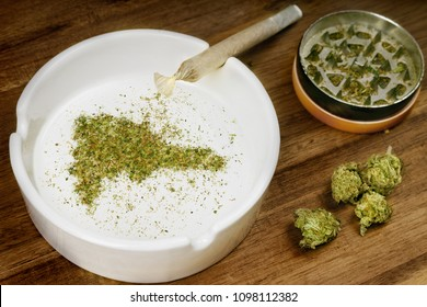 Crumbled weed in the shape of Dominican Republic and a joint. (series)