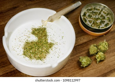 Crumbled weed in the shape of Guatemala and a joint. (series)