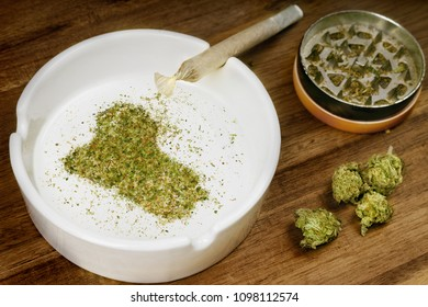 Crumbled weed in the shape of Iraq and a joint. (series)