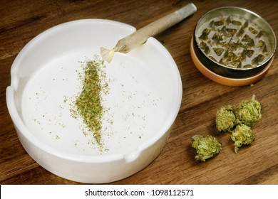 Crumbled weed in the shape of Israel and a joint. (series)