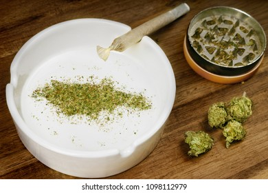 Crumbled weed in the shape of Jamaica and a joint. (series)
