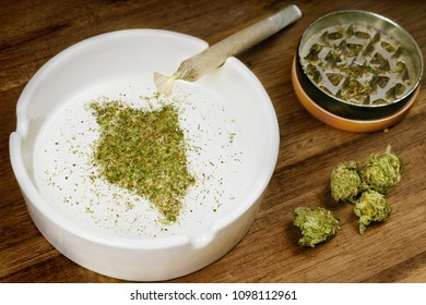 Crumbled weed in the shape of Kenya and a joint. (series)
