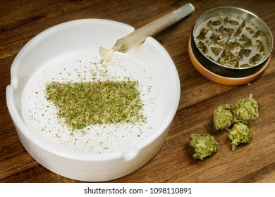 Crumbled weed in the shape of Montana and a joint. (series)