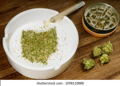 Crumbled weed in the shape of Ohio and a joint. (series)