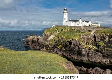Crumbling cliffs, breaking waves and expansive seascapes; enter a world of raw nature and peaceful solitude at Fanad Head . Located on the Fanad peninsula Donegal, Ireland