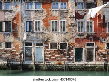 Crumbling colorful building on a canal in Venice