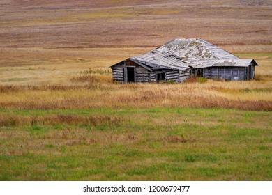 A crumbling farm building out on the Canadian praries.