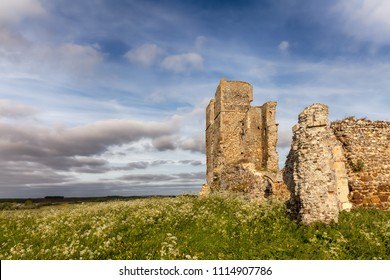 Crumbling ruined church on top of a hill with great views over the English rural landscape
