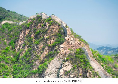 A crumbling section of the great wall of china at the Huanghua cheng scenic area  in the west of Beijing china on a sunny summer day.