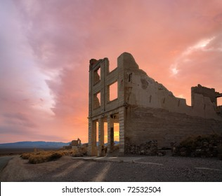 A Crumbling Structure Under Restless Sunset Skies At Rhyolite Nevada, An Abandoned Town Near Death Valley, USA