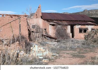 Crumbling walls and melting adobe bricks show on an abandoned house in the high plains of New Mexico.