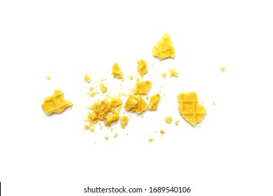 Crumbs of waffle crisp butter flavor biscuits isolated on white background.