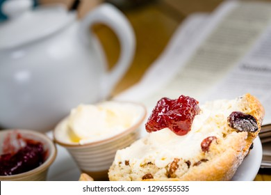 Crumpets with jam and creme